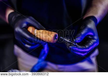 2cyberpunk Tattoo Parlor. The Master Puts A Needle In The Tattoo Machine