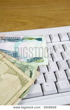 Pakistani Money On Computer Keyboard