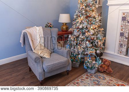 Classic Christmas Decorated Interior Room, New Year Tree With Silver Decorations. Modern Blue Classi