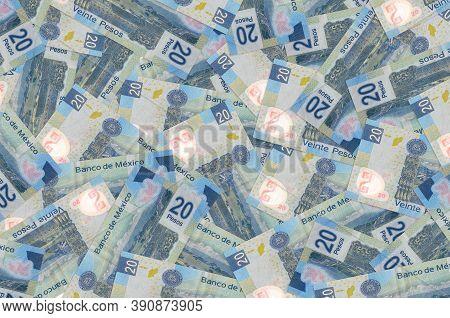 20 Mexican Pesos Bills Lies In Big Pile. Rich Life Conceptual Background