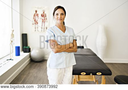 Portrait Of A Physiotherapy Woman Smiling In Uniforme
