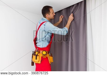 Handy Man Home Installation And Repair Service Technician Or Home Owner Hanging Curtains For The Win