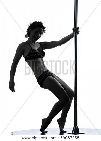 one causasian woman pole dancer dancing in silhouette studio isolated on white background