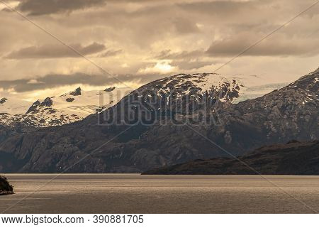 Sarmiento Channel, Chile - December 11, 2008: Amalia Glacier And Fjord. Snow On Mountain Ramge Under