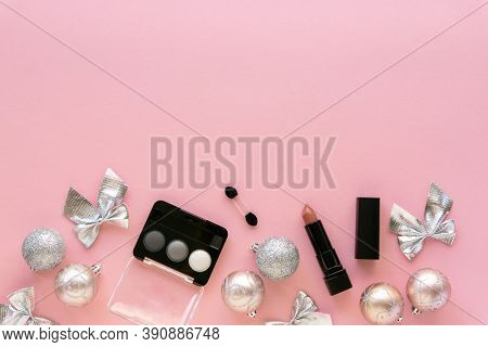Christmas Or New Year Flat Lay Of Makeup Products And Decorations. Eyeshadow Palette And Lipstick On
