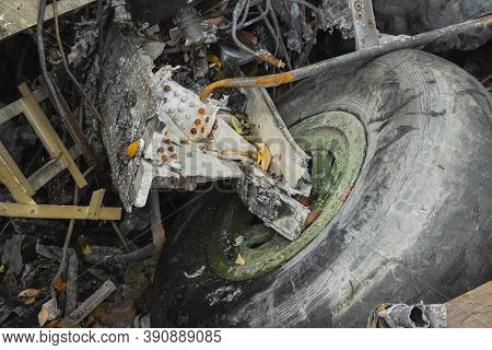 Plane Wreckage, Parts Of The Fuselage And Landing Gear With The Wheel Of The Burned And Broken Aircr