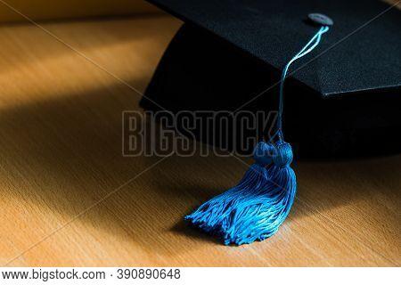 Phd Graduate In Black Hat University Degree Blue Tassel Showing