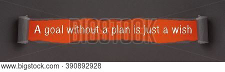 A Goal Without A Plan Is Just A Wish - Motivational Text On Red Background Appears Behind Torn Paper