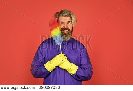 Hipster Holding Cleaning Tool. Cleaning Service. Cleaning Home Concept. Small Colorful Duster Broom.