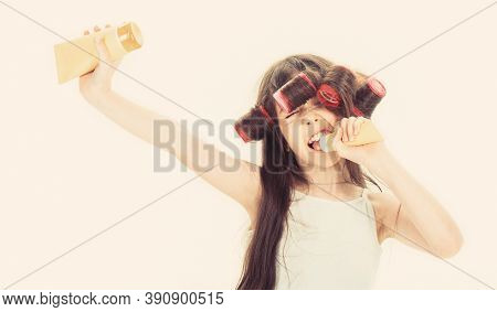 Little Girl Is Holding A Tube For The Cream. Cute Teen Putting Cream On Her Face. Little Girl In Hai