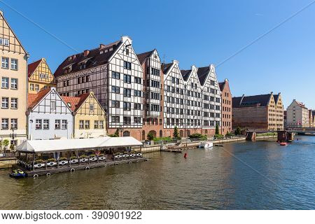 Granaries At The Bank Of Motlawa River On The Granary Island In Gdansk, Poland