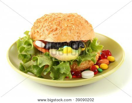 Conceptual image for nutritional care:assorted vitamins and nutritional supplements in bun.Isolated on white poster