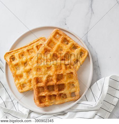 Perfect Savory Keto Waffles. Two Ingredients Chaffles On Plate Over White Marble Background. Eggs An