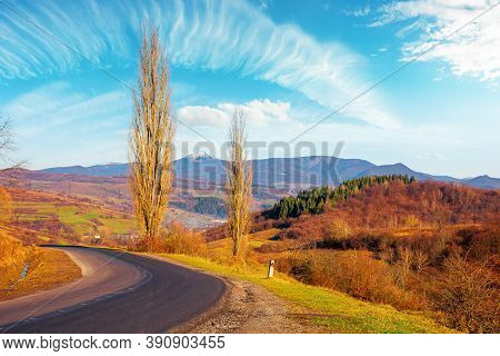 Country Road In Autumn. Morning Scenery In Mountainous Rural Area. Trees In Fall Foliage On The Pass