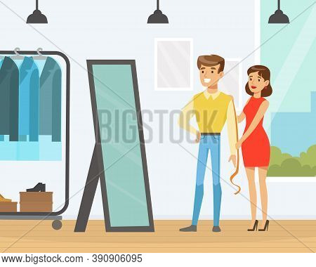 Young Man Making Clothes At Tailor, Woman Dressmaker Measuring Man With Tape For Suit Sewing Cartoon