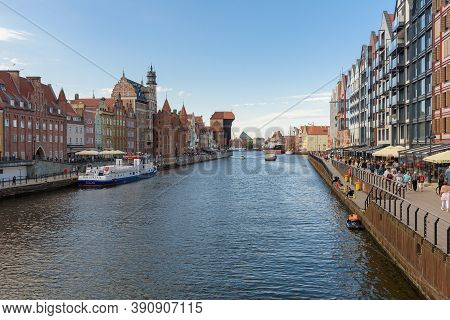 Gdansk, Poland - June 14, 2020: People Walk Famous Promenade At Motlawa River In The City Downtown