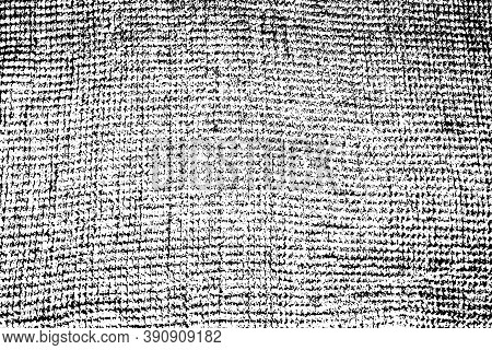 Grunge Texture Of Uneven Rough Fabric. Monochrome Background Of A Waffle Towel With Spots, Noise And