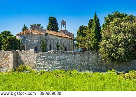 Beautiful Ancient Town Of Osor On The Island Of Cres In Croatia, Stone Walls And Cathedral Tower