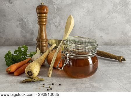 Homemade Beef Bone Broth With Ingredients. Contains Minerals And Healthy Nutrients, Including Vitami