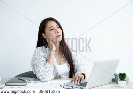 Asian Women Are Tired From Work, Sit In A Chair, Stretch And Massage Neck, Arm, Shoulder For Relaxat