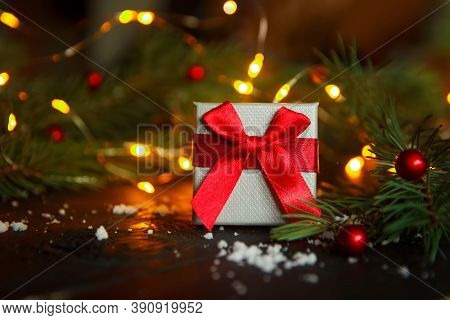 Christmas Greeting Card Concept. Gift Box With Christmas Tree And Lights. Copy Space