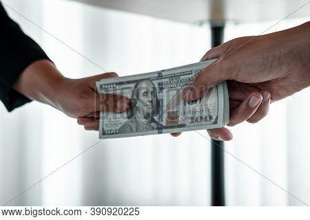 Business People Giving Bribe Money Under Table To Hand Of Their Partner To Give Success The Deal Con