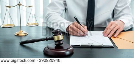 Male Lawyer Working With Legal Case Document Contract In Office, Law And Justice, Attorney, Lawsuit