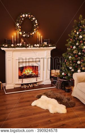 Fireplace And Gifts Under The Christmas Glowing Tree, Vertical Photo. Christmas Home Decor. Beautifu
