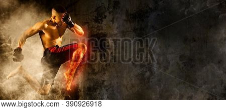 Mixed martial arts fighter (MMA) jumping with a knee kick. Sports banner