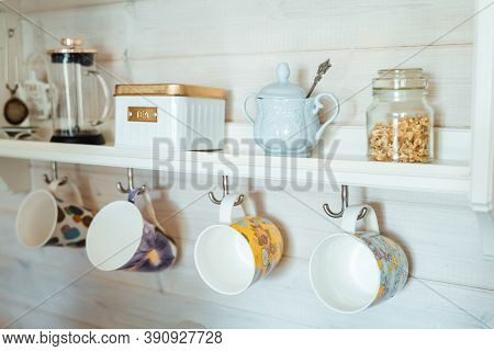 Kitchen Wooden Shelf With Tea Leaves In Gold Box And Accessories, Blue Sugar Bowl With Spoon, Strain