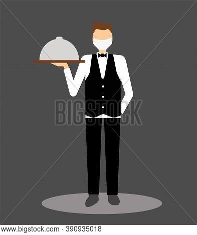 Waiter In Face Mask Serves Food. Waiter On Dark Background. Food Deliveryman During Coronavirus Pand