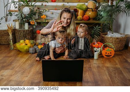 Holidays In The Time Of Covid. Happy Family, Mother And Baby Celebrating Halloween Via Internet In N