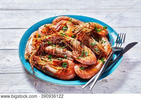 Garlic Butter Jumbo Shrimps Cooked On A Skillet With Lime And Fresh Parsley Of Big Size Whole Pink S