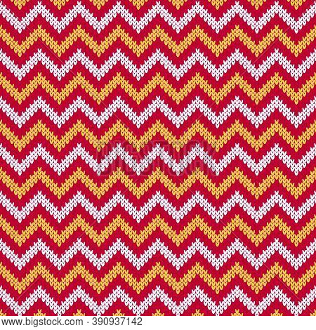 Red knitted sweater chevron stripe seamless pattern. Classic red winter pattern with white and yellow stripes on red background. Knitted texture zig zag backdrop.