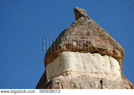 Strange Stone Formations With Blue Sky In The Background. Volcanic Rock Formations. Cappadocia, Turk