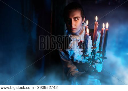 A bloodthirsty vampire aristocrat sneaks around smoke castle in the night in search of a victim. 19th century style. Halloween.