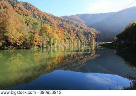 Autumn landscape with lake on Tereblya mountain river in ukrainian Carpathians