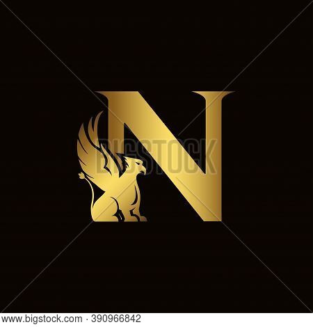 Griffin Silhouette Inside Gold Letter N. Heraldic Symbol Beast Ancient Mythology Or Fantasy. Creativ