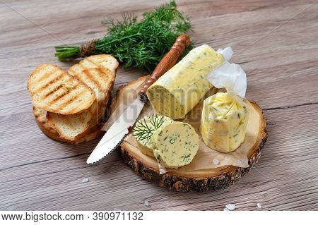 Healthy Butter With Dill, Parsley In The Form Of A Roll, Slices For Easy Use. Herbal Butter On A Cut