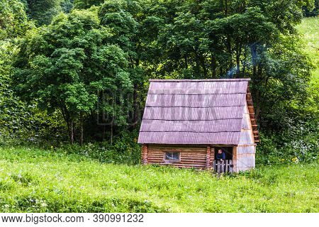 Zakan, Russia - June 24, 2010: Caucasus Mountains Countryside. Hunter's Rustic Hut In Forest On Glad