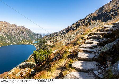 Stony Mountain Trail Leading To Szpiglasowy Wierch Mount In Tatra Mountains, With Crystal Blue Mount