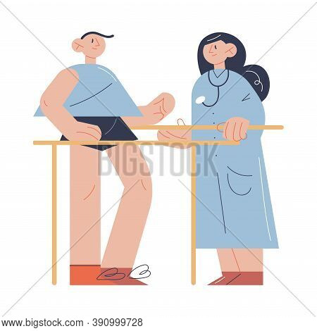 Woman Therapist Helping Man Patient With Exercising During Program Of Health Rehabilitation