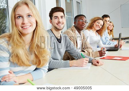 Happy students learning together in a university seminar