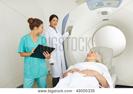 Radiologist and nurse with senior patient in MRI in a hospital