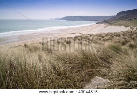 Sennen Cove beach and sand dunes before sunset Cornwall England