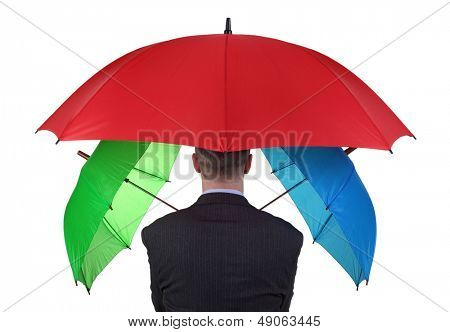 Confident businessman with three umbrellas concept for more than adequate ample cover or backup plan