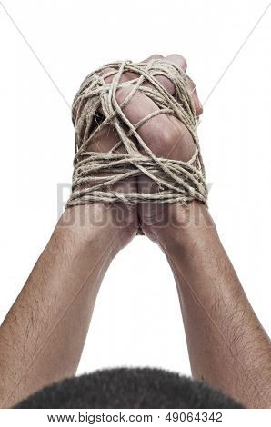 man with his hands tied with rope, as a symbol of oppression or repression, on a white background