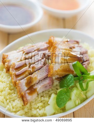 Siu Yuk or sliced Chinese boneless roast pork with crispy skin, serve with steamed rice. Singapore Chinese cuisine.