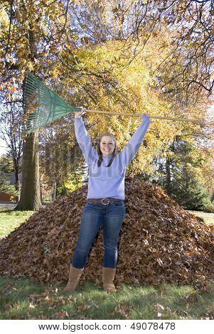 Raking Leaves Triumphant Girl