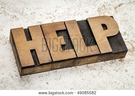 help word   in vintage letterpress wood type on a ceramic tile background